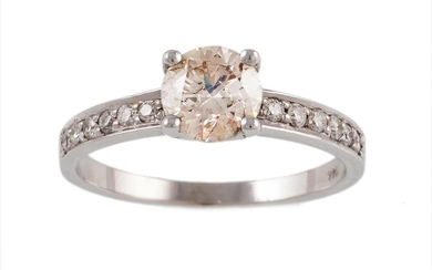A SOLITAIRE DIAMOND RING, the diamond estimated to weigh; 1....