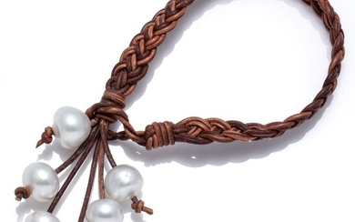 A SOUTH SEA PEARL AND LEATHER BRACELET; braided tan leather adjustable strap to tassel of 6 oval cultured pearls of good colour and...