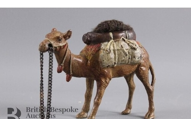 A cold cast bronze camel pin cushion, approx 10 x 8 cms.