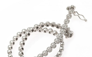 A diamond bracelet set with numerous brilliant-cut diamonds weighing a total of app. 1.87 ct., mounted in 18k white gold. L. app. 18 cm.