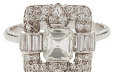 A diamond cluster ring claw set with a central emerald-cut...