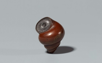 A lacquer on wood netsuke of a snail shell. Mid-19th century