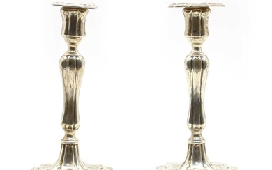 A pair of Edwardian silver candlesticks