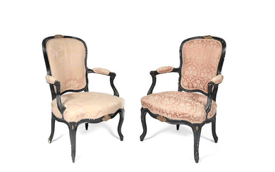 A pair of French 18th/19th century ebonised and parcel gilt fauteuils