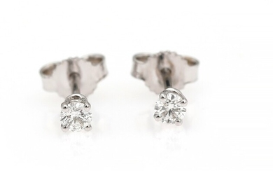 SOLD. A pair of diamond ear studs each set with a brilliant-cut diamond, mounted in...