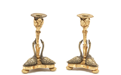 A pair of early Victorian silvered and parcel gilt swan candlesticks
