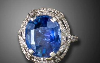 A sapphire and diamond cluster ring, centred with a cushion-shaped sapphire weighing 12.97cts, in an openwork double surround set with graduated old circular-cut diamonds in platinum, size M Accompanied by report number 79216-27 dated 21 June 2019 from...