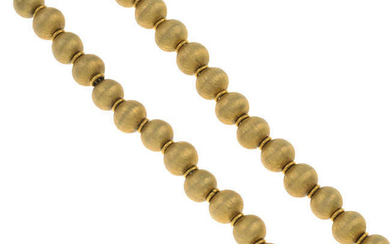 A textured bead necklace.