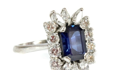 A white gold sapphire and diamond rectangular cluster ring