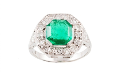 AN EMERALD AND DIAMOND CLUSTER RING, one octagonal step cut ...