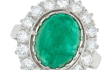AN EMERALD AND DIAMOND CLUSTER RING set with a cabochon