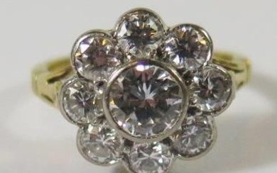 An 18ct Yellow Gold and Diamond Cluster Ring, the central ro...