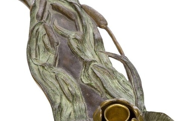 An Art Nouveau patinated bronze candle holder c.1900, indistinct stamped...