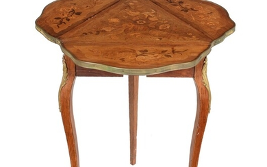 An Italian walnut and marquetry inlaid occasional table