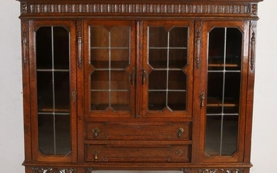 Antique English oak display cabinet with four stained
