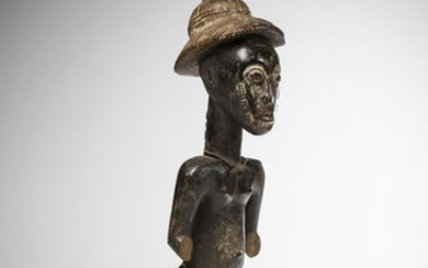 BAOULE, Ivory Coast. Male statue representing a dignitary...
