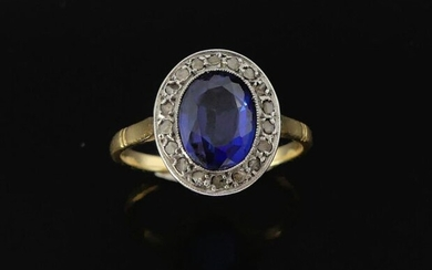 Charming RING two golds, the oval bezel set with a sapphire probably Verneuil in an entourage of roses. Gross weight 2,9 g TDD 53 (central stone to be retightened)