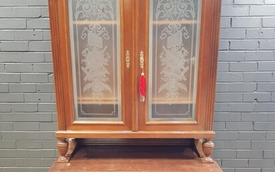 Early 20th Century French Walnut Buffet a Deux Corps, the two upper glass panel doors etched with trophies of the arts, with two dra...