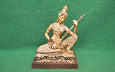 Gilded bronze figure of possibly Tibetan lady playing a musi...