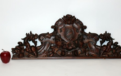 Italian carved walnut crest with crest and chimera