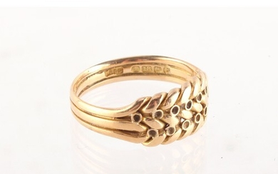 Property of a deceased estate - an 18ct gold ring of braided...