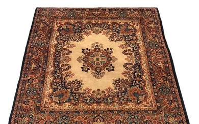 Sarouk Rug, Iran, c. 1940, with eight-pointed floral medallion on an open ivory field, 5 ft. 9 in. x 5 ft. 1 in.