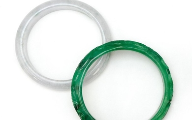 "TWO CHINESE SIMULATED JADE BANGLE BRACELETS One green with carved dragon design, diameter 3"", and one celadon, diameter 3""."
