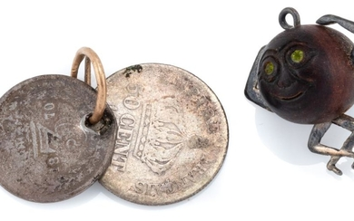 TWO VINTAGE SILVER CHARMS; WWI 'Touch Wud' silver and wood lucky charm and two silver coins, an 1870 three-pence and 1867 50 cents,...