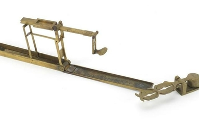 Two sets of antique brass sovereign scales, the largest