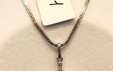 White gold chain supporting a gold and platinum Art Deco pendant circa 1930 - set with diamonds and black onyx baguettes. 8,3g