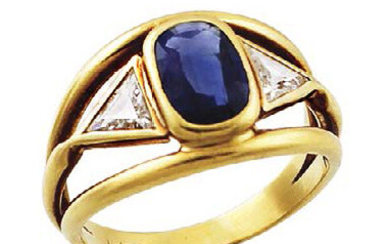 Yellow gold ring with oval sapphire weighing approximately...