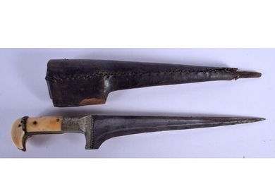 A 19TH CENTURY MIDDLE EASTERN CARVED IVORY HANDLED DAGGER wi...