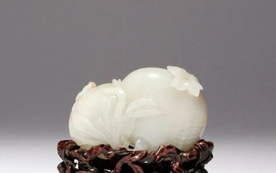 A CHINESE PALE CELADON JADE CARVING OF POMEGRANATES QIANLONG 1736-95...