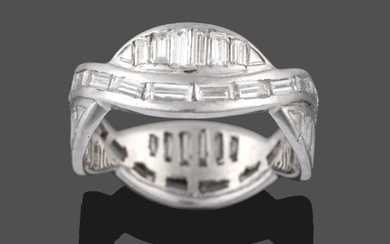 A Diamond Eternity Ring, two entwined rows of baguette cut...