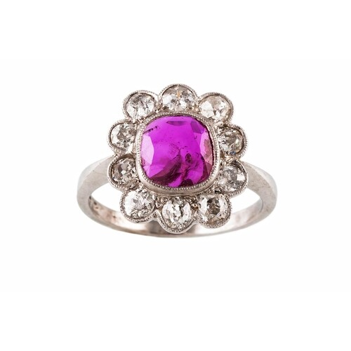 A RUBY AND DIAMOND CLUSTER RING, the cushion cut ruby to an ...