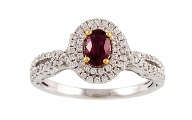 A RUBY AND DIAMOND CLUSTER RING, the oval ruby to diamond su...