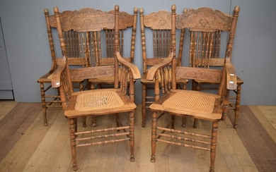 A SET OF SIX AMERICAN OAK SPINDLE BACK DINING CHAIRS, WITH WOVEN CANE SEATS, INCLUDING TWO CARVERS (CANE SEAT A/F TO ONE CARVER) (11...