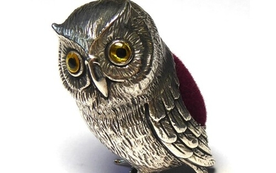 A STERLING SILVER NOVELTY OWL FORM PIN CUSHION Having glass ...