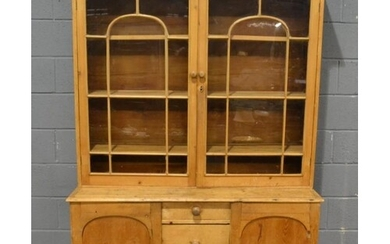 A Victorian and later pine dresser, the glazed double door u...
