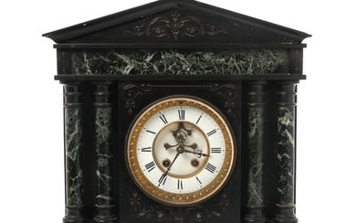 A black marble mantel clock in the shape of a temple. Early 20th century. H. 46,5 cm. W. 45 cm. D. 17 cm.