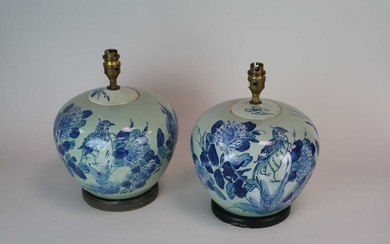 A decorative pair of blue and white desk lamps,...
