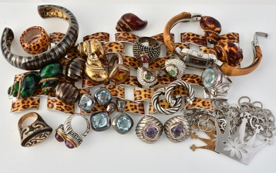 A group of silver coloured and costume jewellery