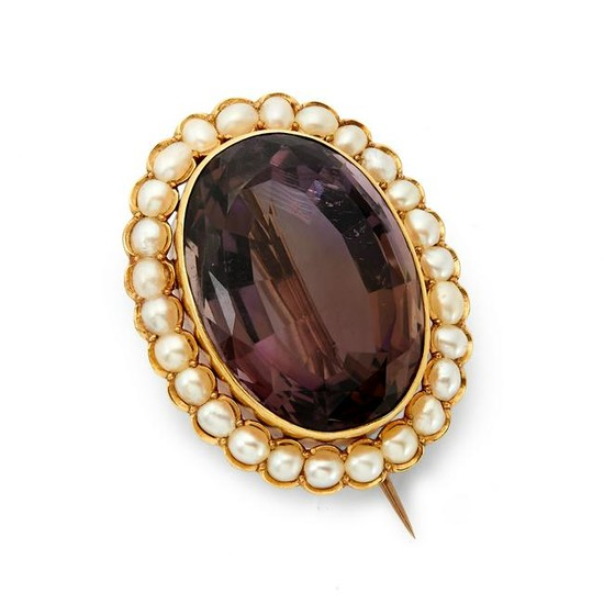 A late 19th century amethyst and split pearl brooch.