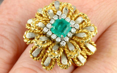 A mid 20th century emerald and diamond bi-colour floral cluster ring.