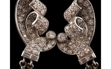 A pair of Art Deco diamond ear clips: each with an open work...