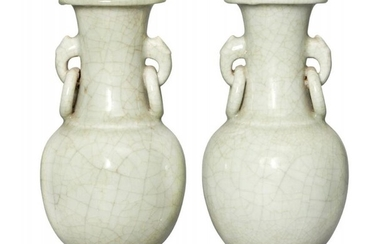 A pair of Chinese celadon porcelain vases,...