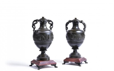 A pair of Continental patinated bronze and rouge marble mounted twin handled urns, late 19th century