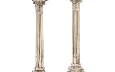 A pair of column shaped English sterling silver candlesticks. Walker & Hall, Sheffield 1895. Filled....