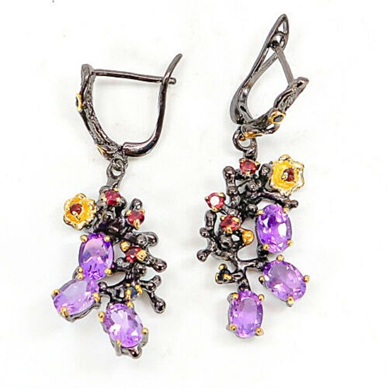 A pair of ear pendants each set with numerous oval and circular-cut amethysts, sapphires and rhodolite garnets, mounted in black rhodium and gold plated silver.