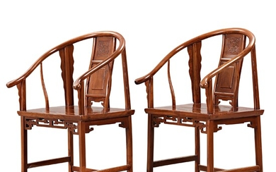 A pair of horseshoe-back armchairs, Qing dynasty (1644-1912).
